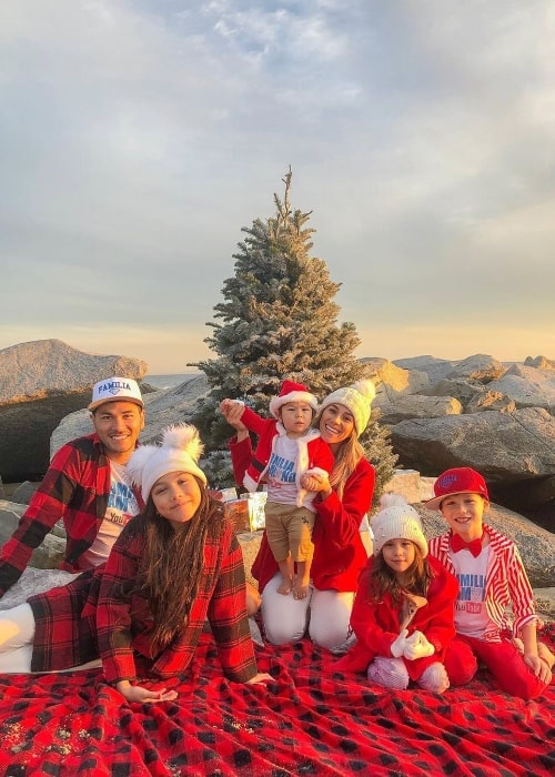 Esthalla smiling in a Christmas picture with her family in December 2019