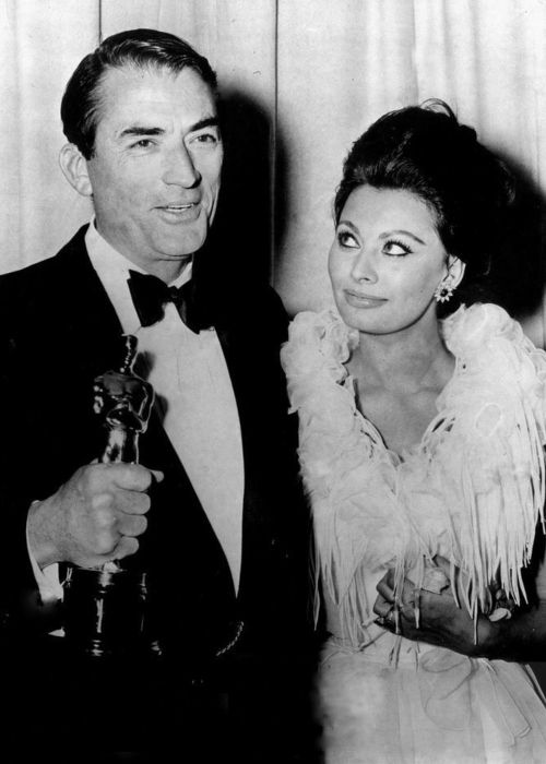 Gregory Peck as seen with Sophia Loren at the Academy Awards in 1963