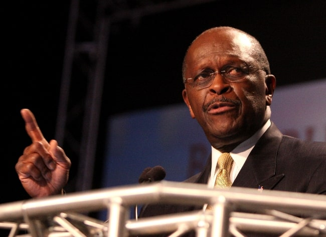 Herman Cain pictured at the Ames Straw Poll in Ames, Iowa in August 2011