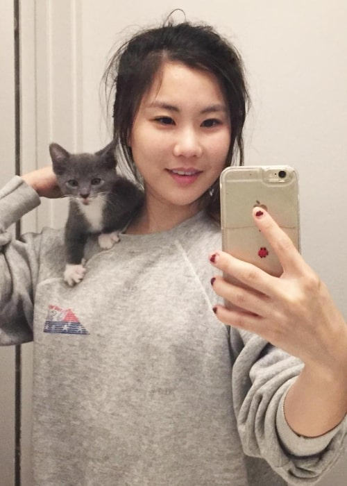Irene Choi having a great time with a kitten in June 2017
