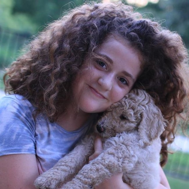 Julia CraftyGirls as seen in a picture with her Poodle named Lily in July 2019