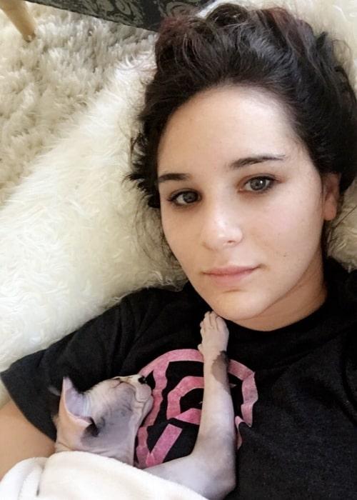 Kelli King as seen in a selfie taken with her cat in August 2016