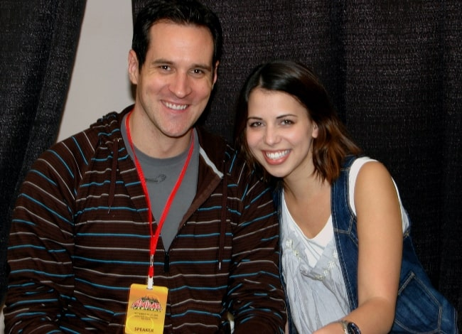 Laura Bailey smiling in a picture alongside Travis Willingham in September 2009