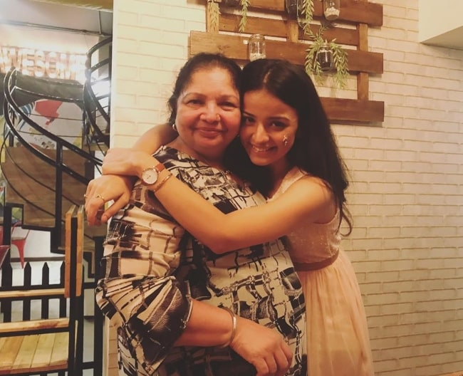 Mahima Makwana posing for a picture alongside her mother
