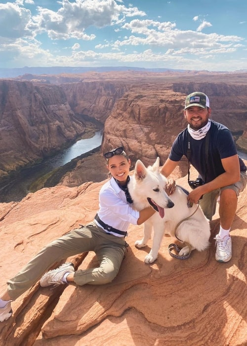 Melody Le as seen in a picture that was taken with her dog Gstaad and husband Christiaan in August 2020, at the Horseshoe Bend in Arizona