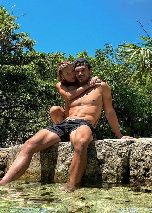Michael Yerger posing for the camera along with Daisy Keech in Tulum, Mexico in June 2020