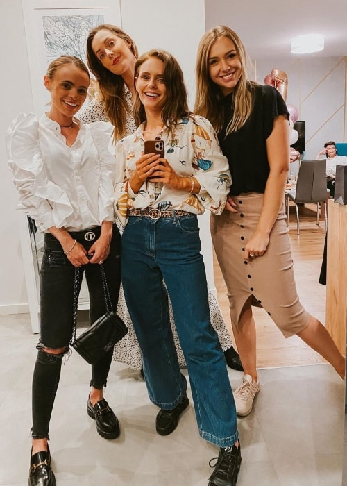 Olga Kalicka as seen in a selfie that was taken with her friends business partner C @ R O L I N E (Left), actress Ewelina Bator (Center), and her friend Paula in August 2020