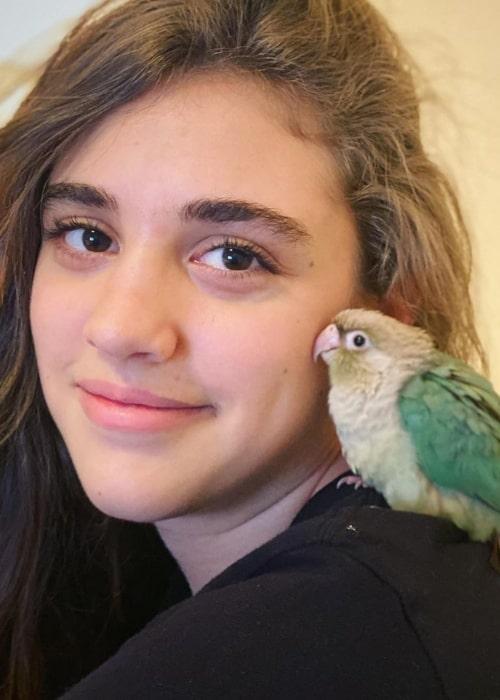 Rachel CraftyGirls as seen in a picture taken with her bird Indigo in March 2020