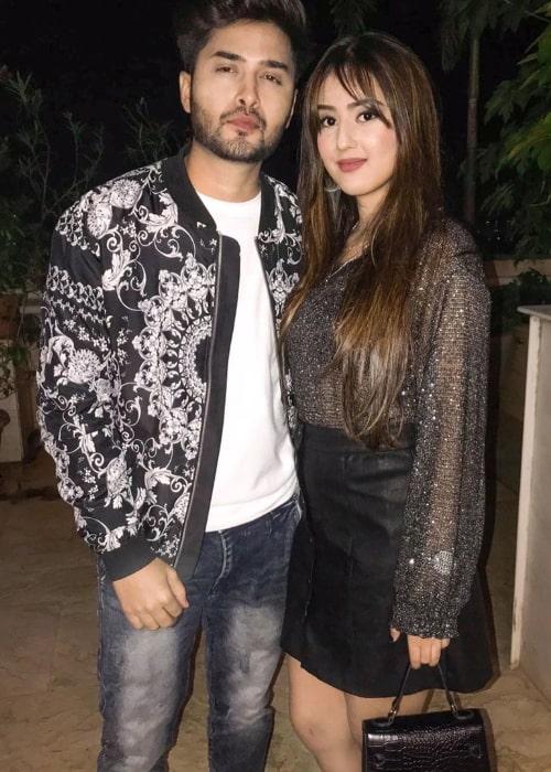 Riya Sharma posing for a picture alongside Sumit Sharnagat in Mumbai, Maharashtra on New Year's Eve 2020