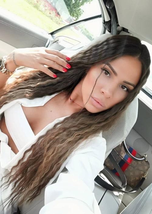 Sandra Afrika as seen while taking a car selfie in June 2019