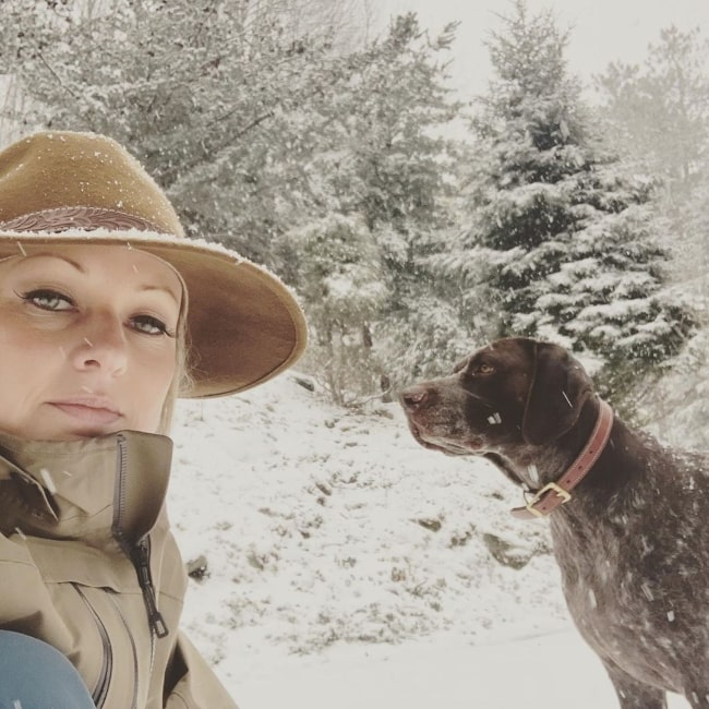 Sandra Smith taking a selfie along with her dog in March 2020