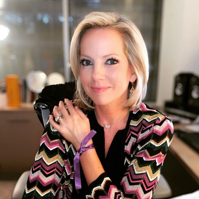 Shannon Bream as seen while smiling for a picture showing her necklace in February 2020