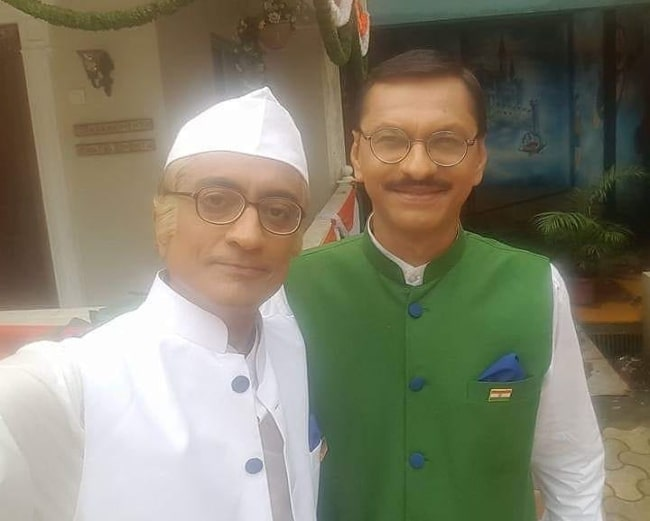 Shyam Pathak (Right) smiling in a selfie alongside Amit Bhatt