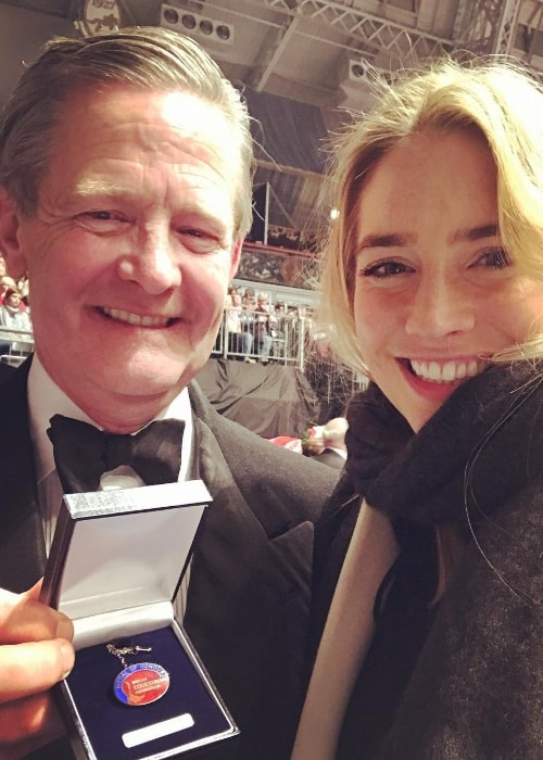 Sophie Colquhoun smiling in a selfie along with her father at London Olympia as he got presented the Medal of Honour for his services to the British