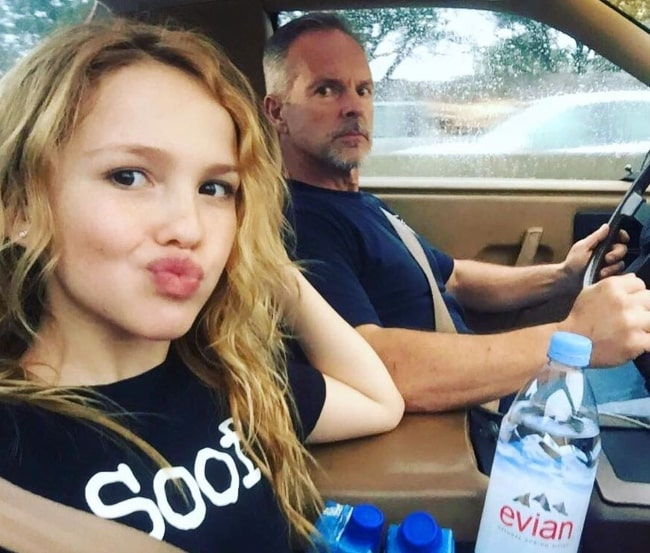 Talitha Bateman pouting for a car selfie alongside her father