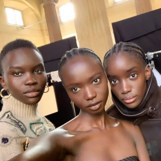 Achenrin Madit as seen in a selfie with fellow models Agi Akur and Maty Fall Diba in February 2020