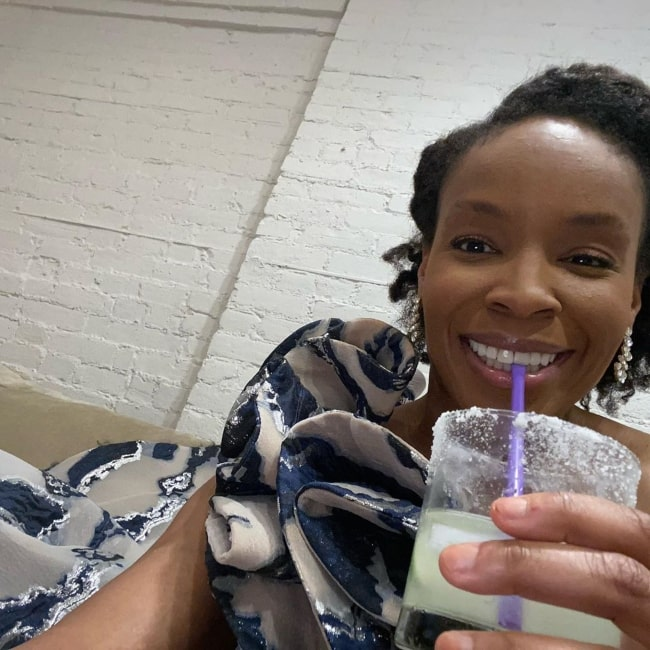 Amber Ruffin enjoying a drink in March 2020