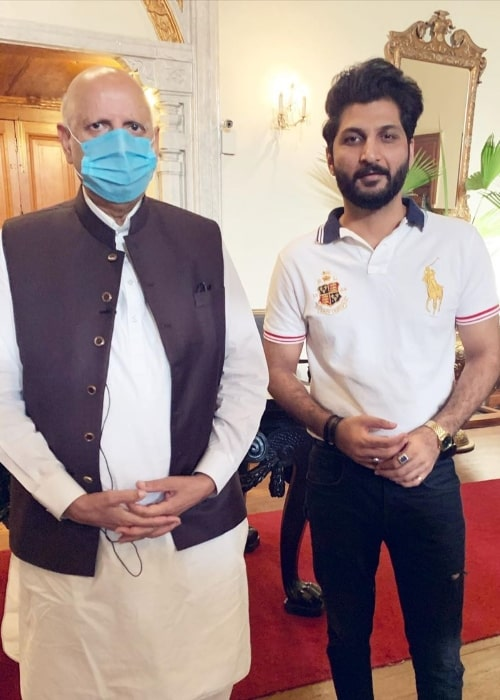 Bilal Saeed (Right) as seen while posing for a picture alongside the 33rd Governor of Punjab Chaudhry Mohammad Sarwar at Governor's House in Lahore, Punjab, Pakistan in July 2020