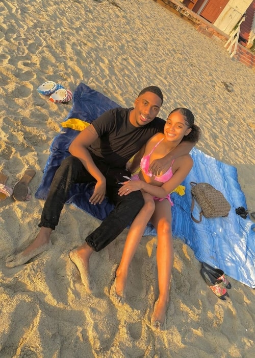 Cameron Christian as seen in a picture that was taken in August 2020, with his girlfriend Nie while relaxing on the beach