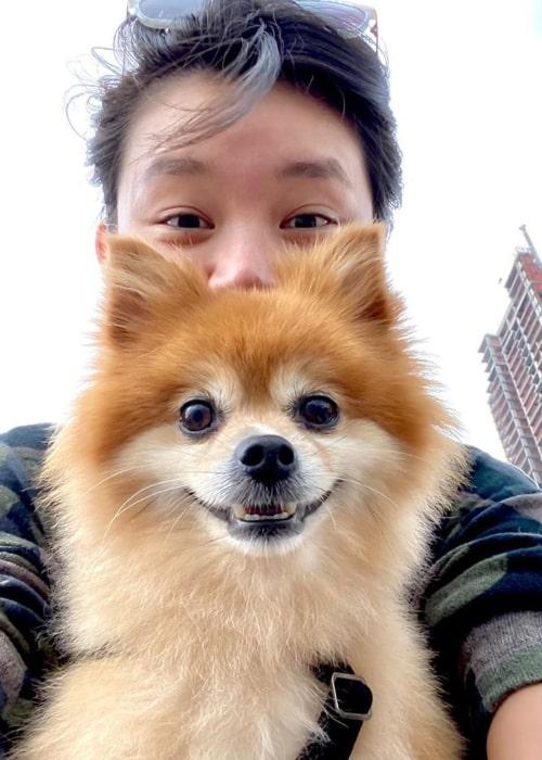 Celia Au as seen in a selfie that was taken with her pomeranian Wookie in New York City, New York in June 2020