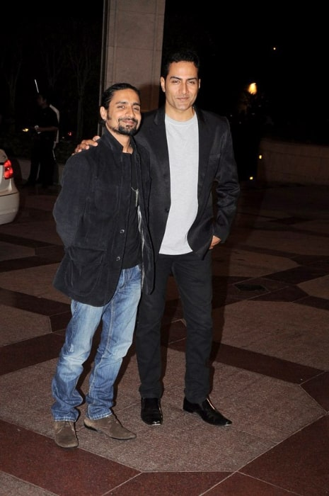 Chandan Roy Sanyal (Left) posing for the camera alongside Sudhanshu Pandey at Esha Deol's sangeet ceremony in July 2012