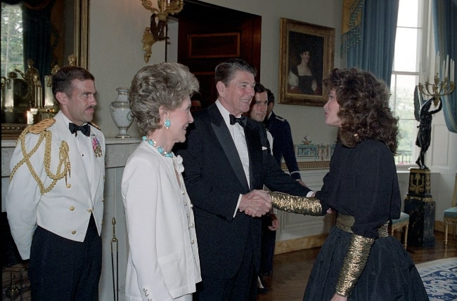 Jaclyn Smith greeting President Ronald Reagan and First Lady Nancy Reagan at a Reception for Major Contributors and Entertainers for The 1986 Ford'S Theater Festival Gala in The Blue Room in June 1986