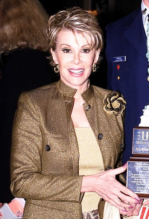 Joan Rivers smiling for a photograph at the USO luncheon at The Pierre hotel in New York City on May 24, 2001