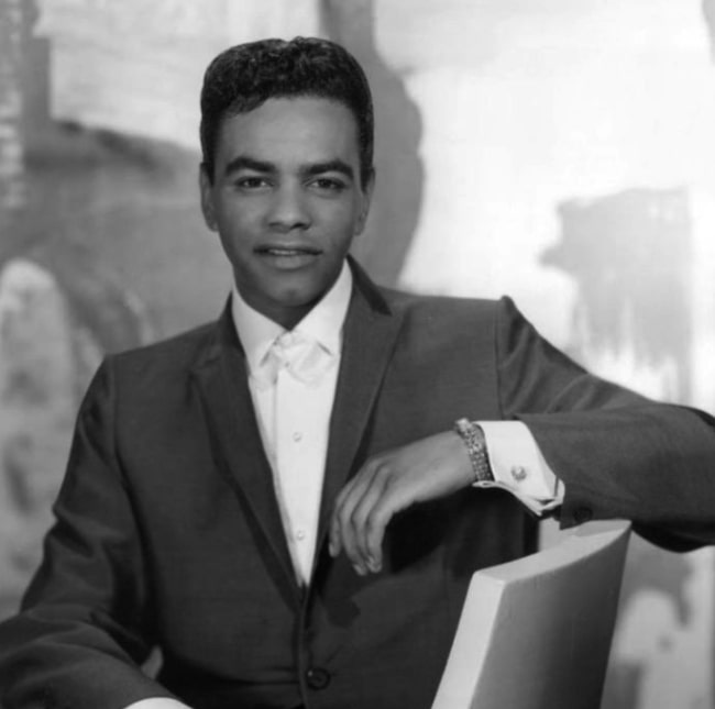 Johnny Mathis as seen in a black-and-white picture
