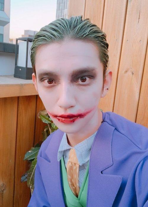 Joshua taking a selfie dressed as the Joker on Halloween in 2018