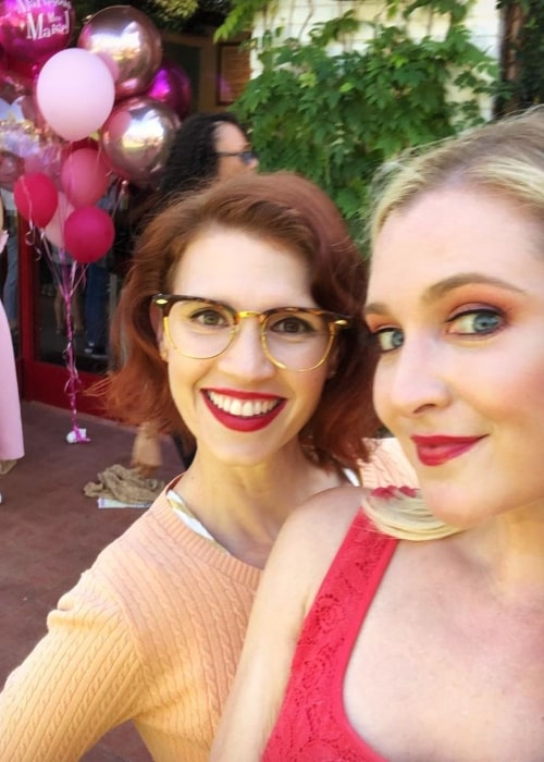 Julie McNiven (Left) as seen while smiling in a selfie alongside Katherine Bailess in August 2019