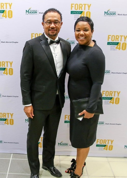 Kellie Shanygne Williams as seen while smiling for the camera alongside her husband at the George Mason University Black Alumni Forty Under 40 event in October 2019