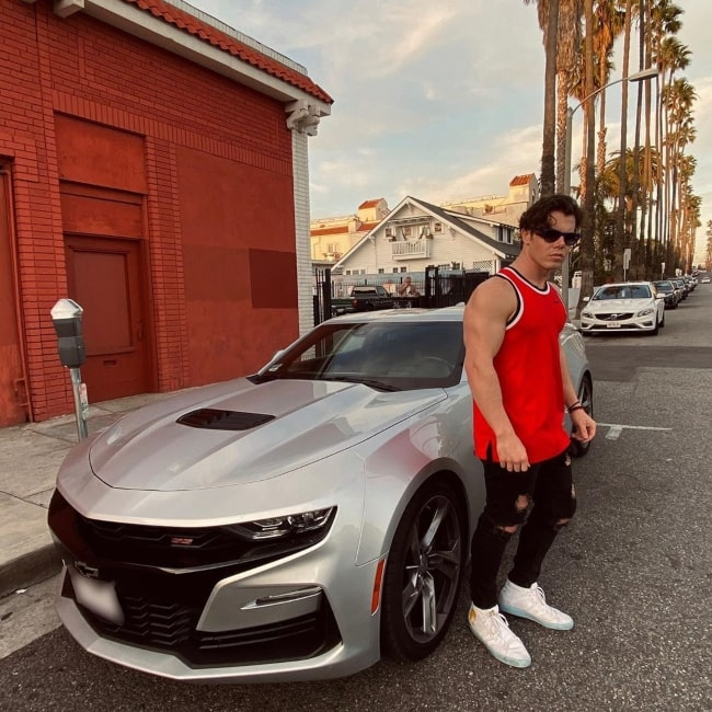 Maximilian Acevedo as seen in a picture with his Camero SS in Los Angeles, California in August 2020