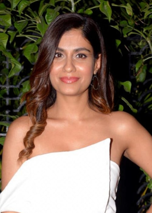 Shreya Dhanwanthary smiling for the camera at Soho House in January 2019