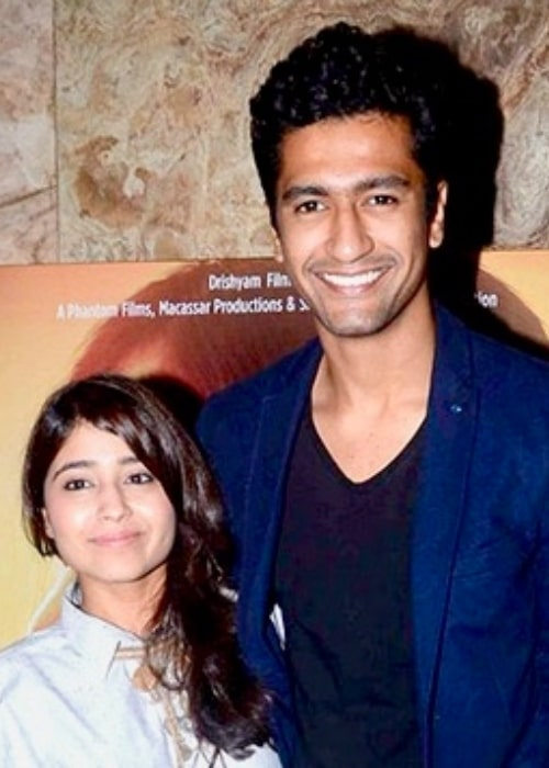 Shweta Tripathi and Vicky Kaushal posing for the camera at a screening of 'Masaan' in 2015