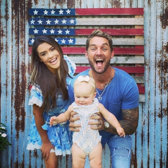 Taylor Mills as seen in a picture that was taken with her husband Brett Young and their daughter Presely Elizabeth in July 2020, in Franklin, Tennessee
