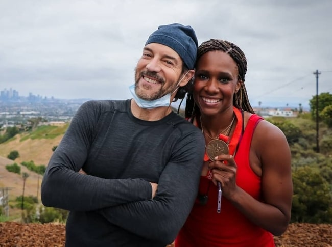 Tony Horton as seen while smiling for a picture alongside British Olympic bronze medallist Tasha Danvers in June 2020
