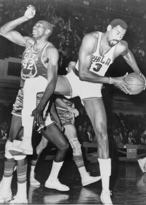 Wilt Chamberlain (Right) and Nate Thurmond pictured during a basketball game in 1966