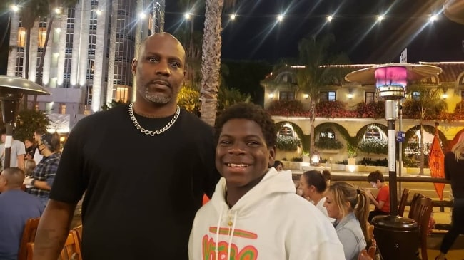 Artyon Celestine (Right) as seen while smiling for a picture alongside rapper DMX in August 2020