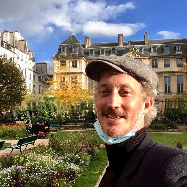 Bruno Gouery as seen while smiling in a selfie in Marais District in October 2020