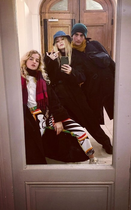 Camille Razat as seen while clicking a mirror selfie with Adèle Farine (Left) and Etienne Baret in December 2019