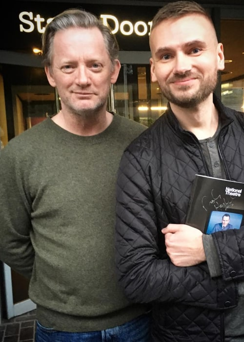 Douglas Henshall posing for a photograph with a fan, in March 2018