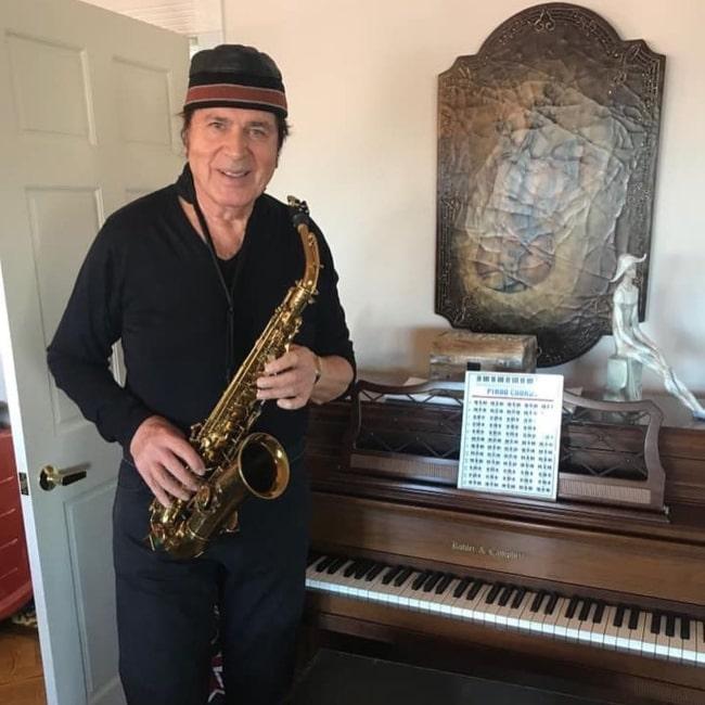 Engelbert Humperdinck in December 2018 enjoying playing the saxophone while recalling fond memories
