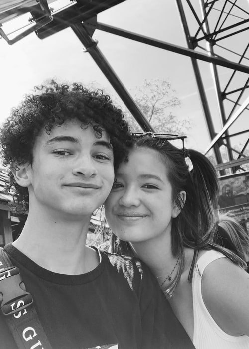 Faly Rakotohavana as seen in a black-and-white picture with Peyton Elizabeth Lee at Canada's Wonderland in June 2019