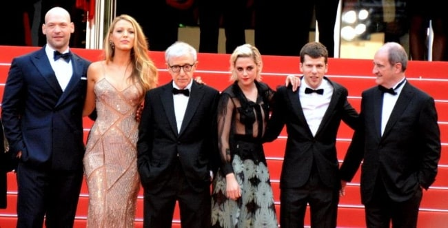 From Left to Right - Corey Stoll, Blake Lively, Woody Allen, Kristen Stewart, Jesse Eisenberg, and Pierre Lescure posing for the camera as the cast and crew of 'Café Society' at the 2016 Cannes Film Festival