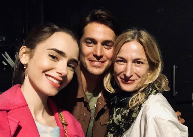 From Left to Right - Lily Collins, Lucas Bravo, and Zoe Cassavetes smiling for a selfie in Paris, France in September 2019