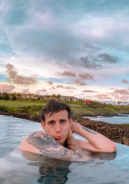 Illenium enjoying himself in the water in July 2019