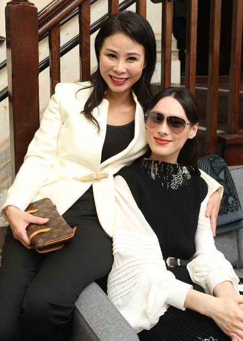 Isabella Leong (Right) as seen while smiling for a picture alongside her friend in Tai Kwun