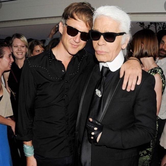 Jefferson Hack (Left) posing for a picture alongside Karl Lagerfeld