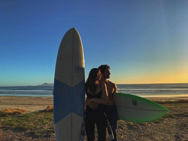 Jordi Webber with Holli Hughes at Te Arai Reserve Beach in New Zealand in March 2020