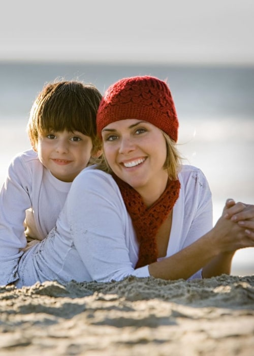 Leanza Cornett, pictured with one of her sons at a beach
